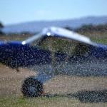 Bradelaide Multimedia Photography for the Aldinga Airfield website - light plane parked through sprinkler
